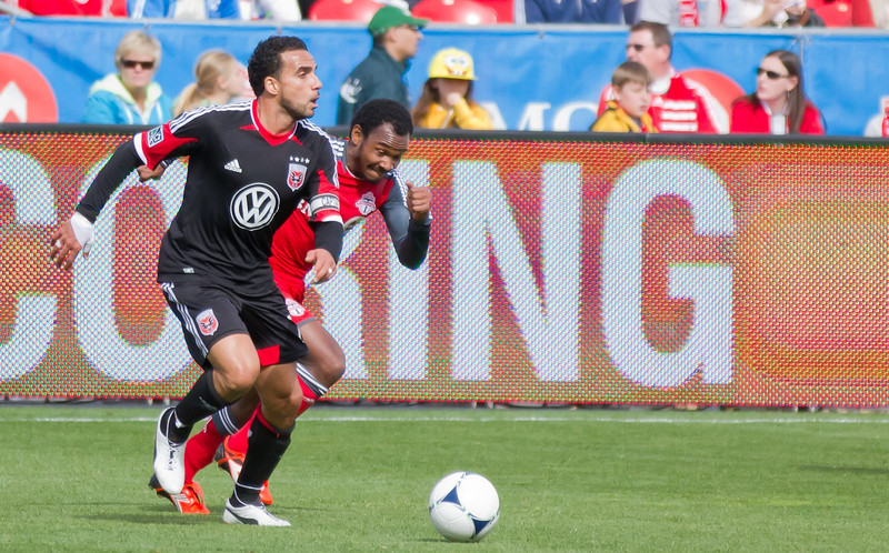 Julian de Guzman tries to keep up with De Rosario in the first of Saturday's game. The TFC midfielder shadowed his old teammate and shut him down in the opening 45 minutes (JP Dhanoa)