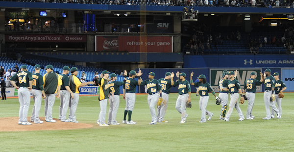 The Athletics celebrate its 7-2 win over the Blue Jays in the first of a three-game series at Rogers Centre. Oakland is the hottest team in baseball with a 15-2 record in July (Karan Vyas)