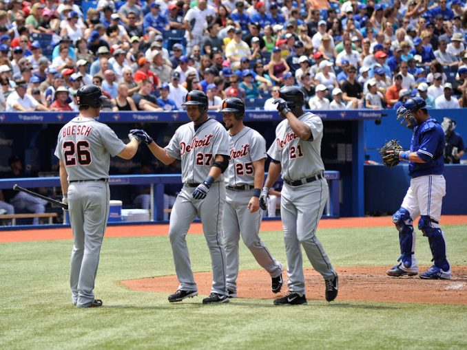 Detroit Tigers shortstop Jhonny Peralta (centre) celebrates his three-run home run with his teammates Brennan Boesch, Ryan Raburn and Delmon Young in the second inning. That was all the offence the Tigers would need as the visitors avoided a three-game sweep with a 4-1 win over the Toronto Blue Jays at Rogers Centre (John Lucero)