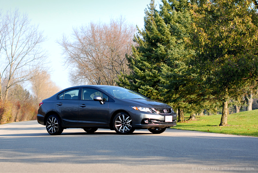 Dark accents, smooth lines, confident stance. The 2013 Honda Civic EX-L