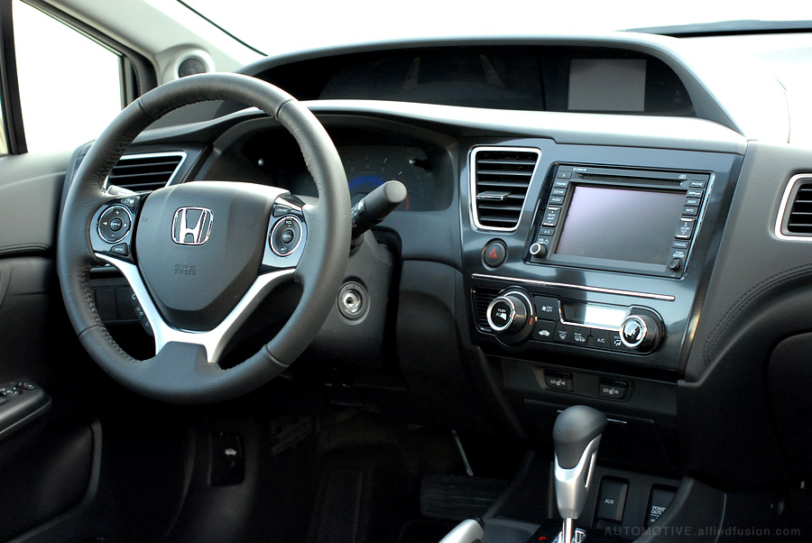 An upscale interior in both look and feel. 2013 Honda Civic EX-L