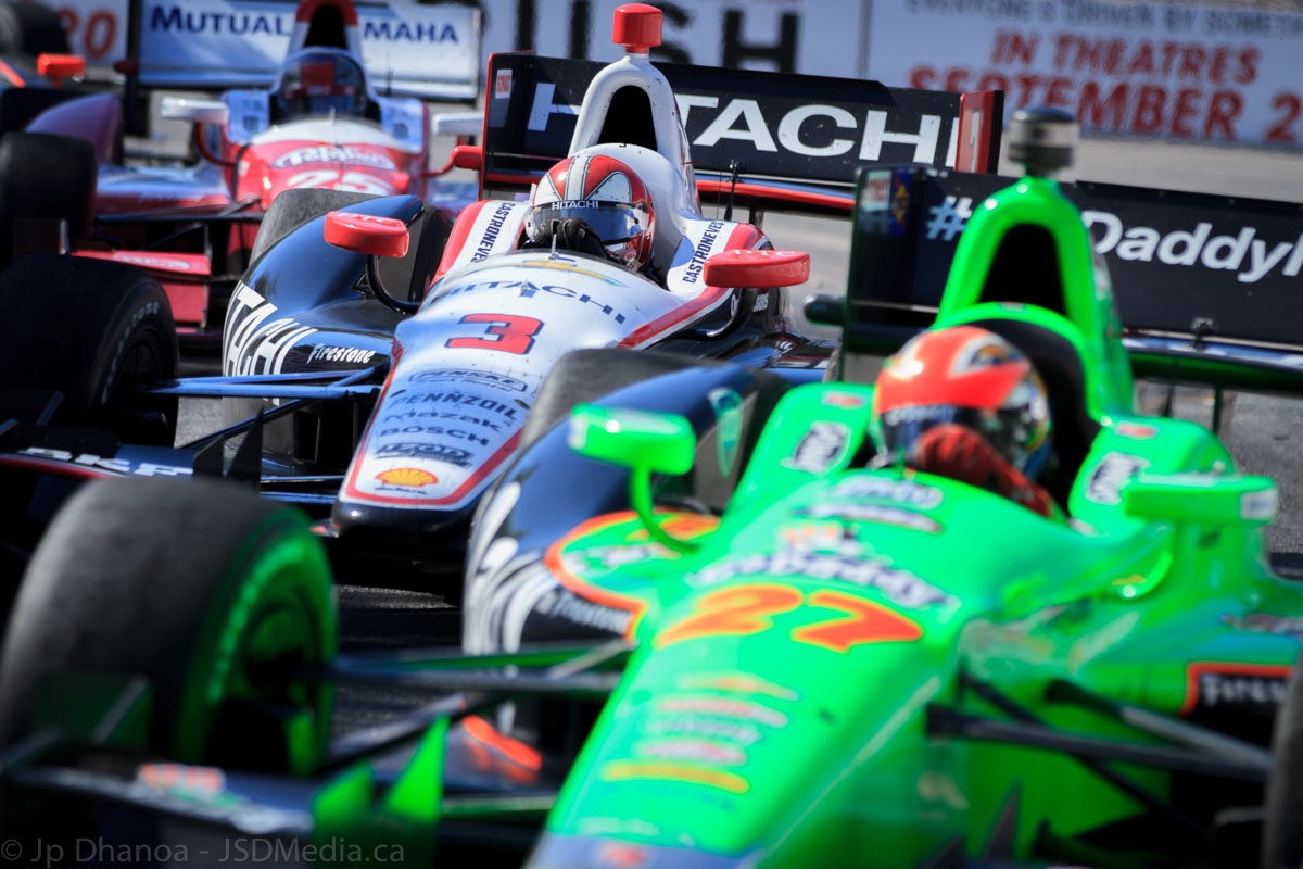 Bumbper to bumper racing at the Honda Indy Race 1 in Toronto. Pictured here: Canadian driver James Hinchcliffe followed closely by Brazilian driver Helio Castroneves and American driver Marco Andretti.