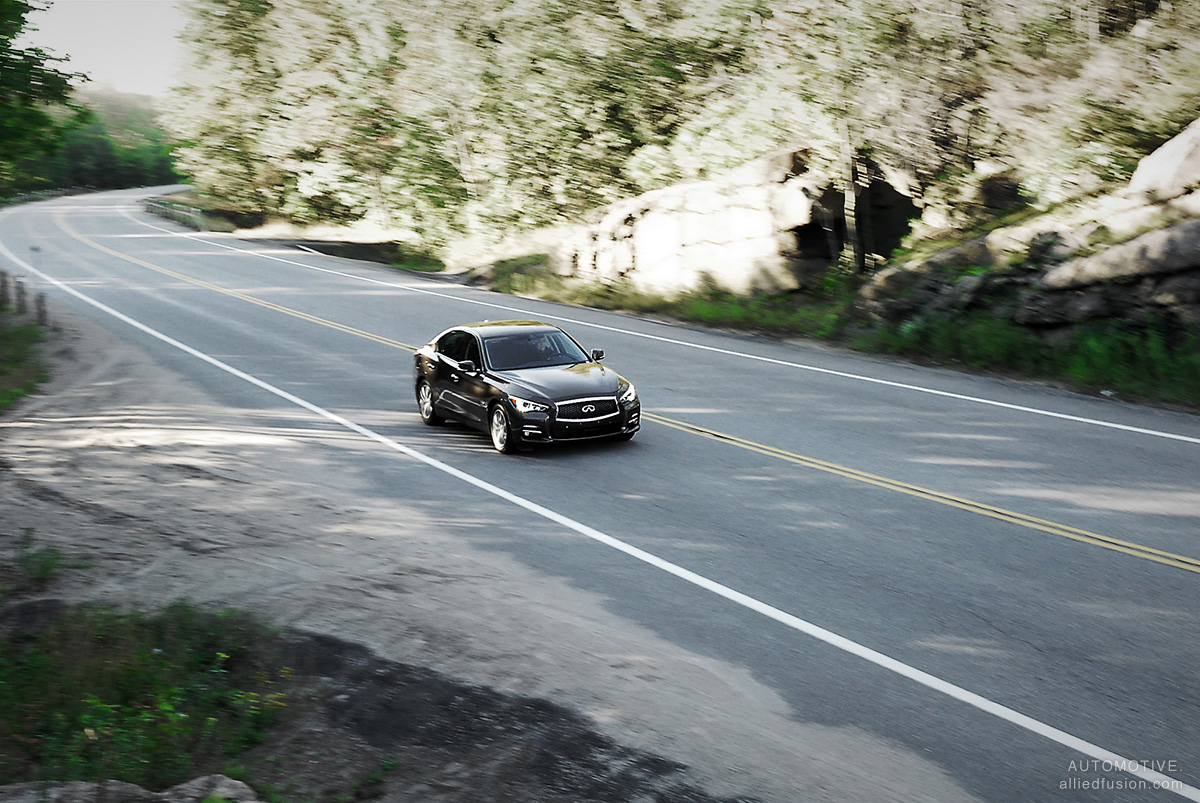 The 2014 Infiniti Q50 on a scenic by road in Ontario's cottage country