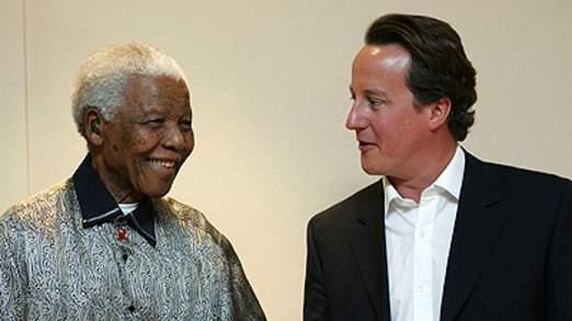Former South African President Nelson Mandela with U.K. Prime Minister David Cameron