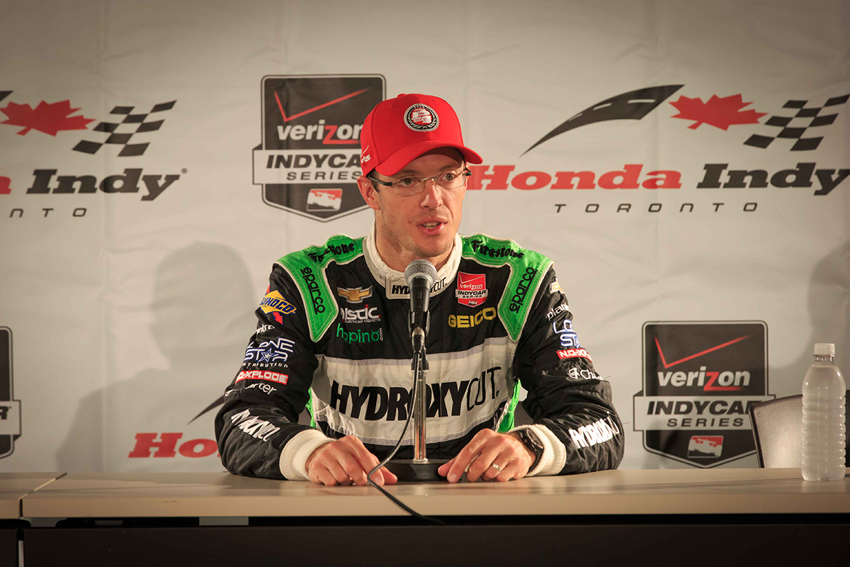 Sebastien Bourdais addresses media after his pole position finish in the Race 1 qualifier