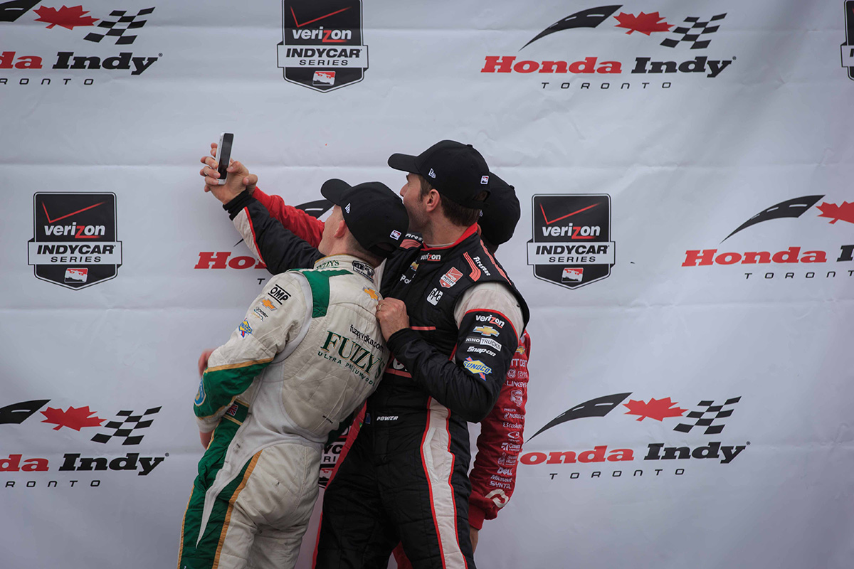 Race 2 podium finishers Conway, Kanaan and Power stop for a quick selfie before getting their trophies