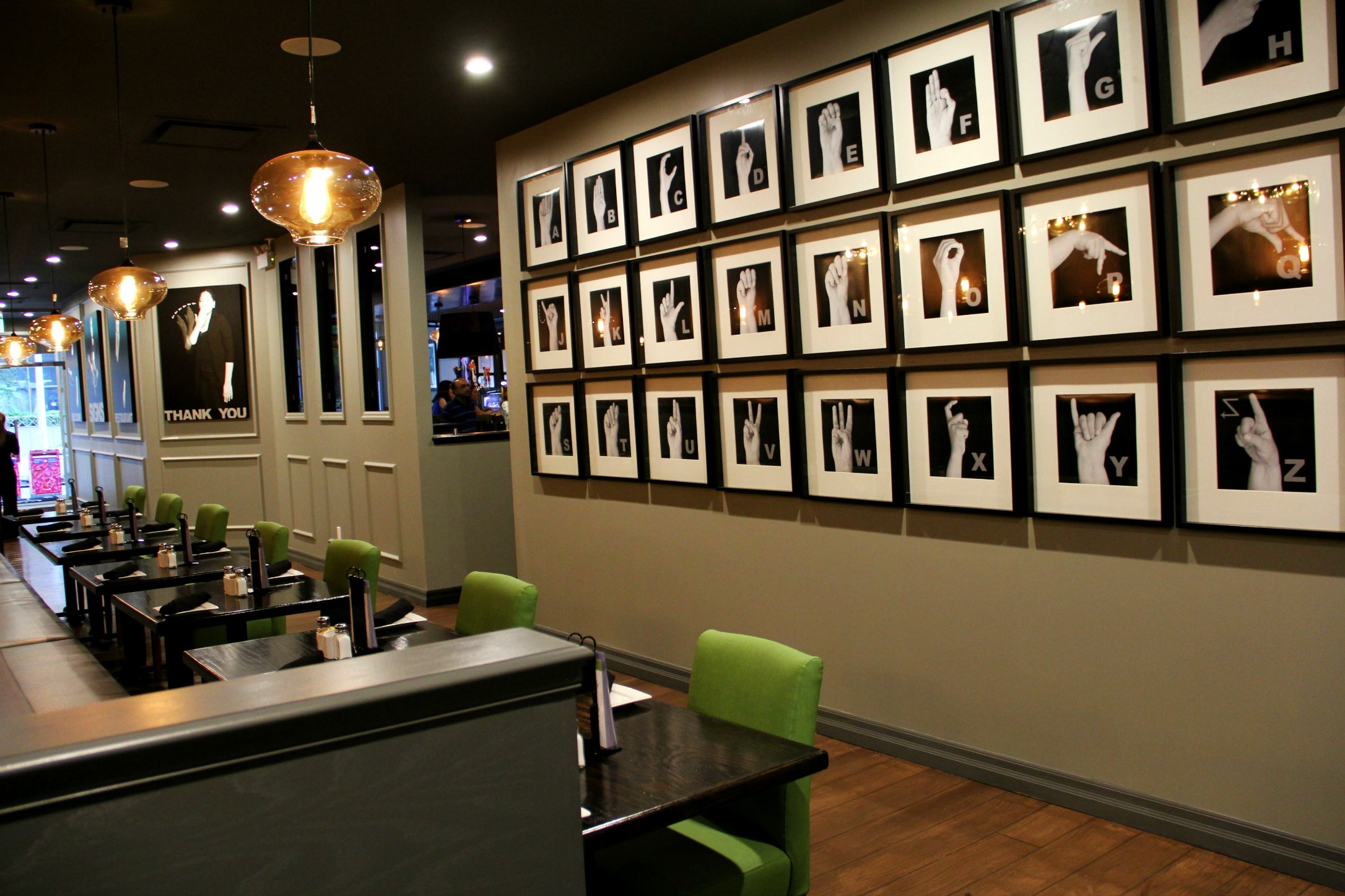 The interior of SIGNS Restaurant & Bar, 558 Yonge St., in Toronto displaying photos of Signing on their walls.