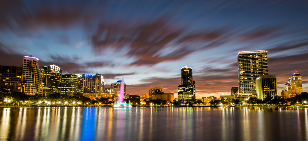 Sunset view of Downtown Orlando across Lake Eola