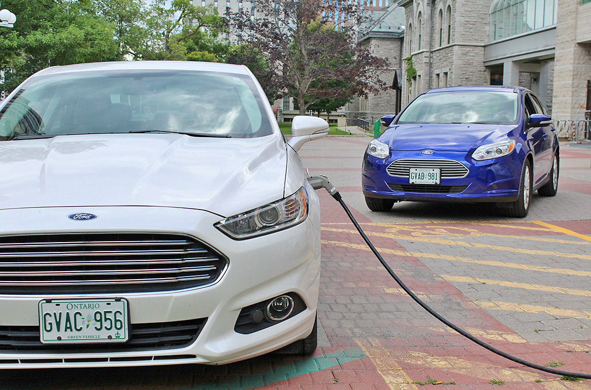 A Fusion Energi being charged while the 2015 Focus Electric waits in the wings