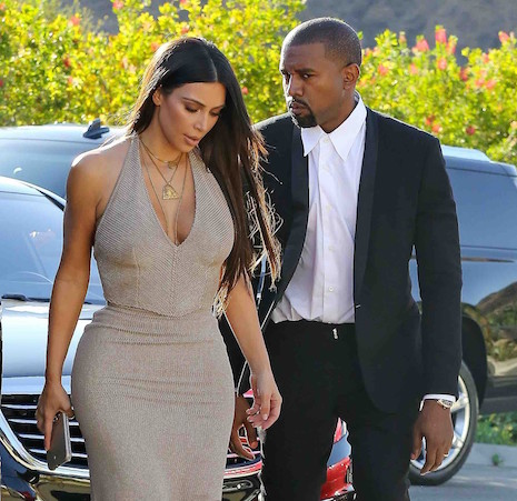 Kim Kardashian shows off her sexy curves for a friend's wedding