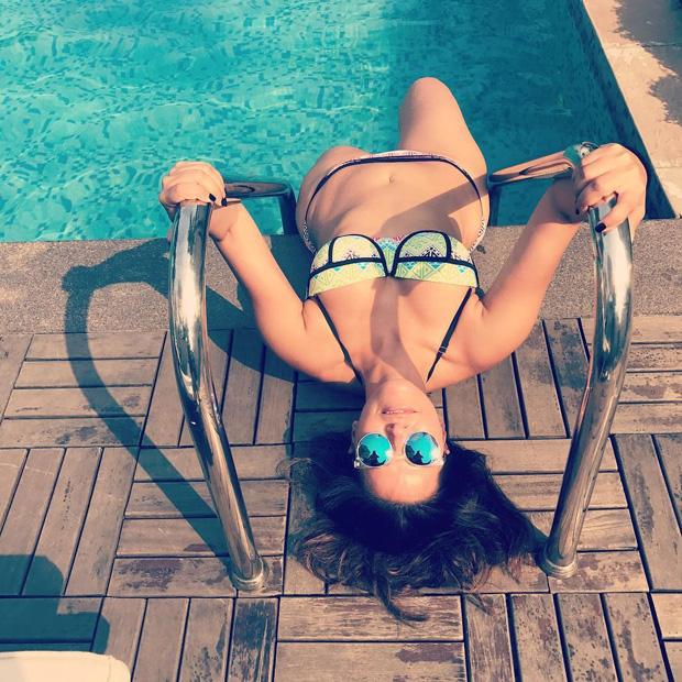 Neha Dhupia enjoys the summer in a bikini by the pool