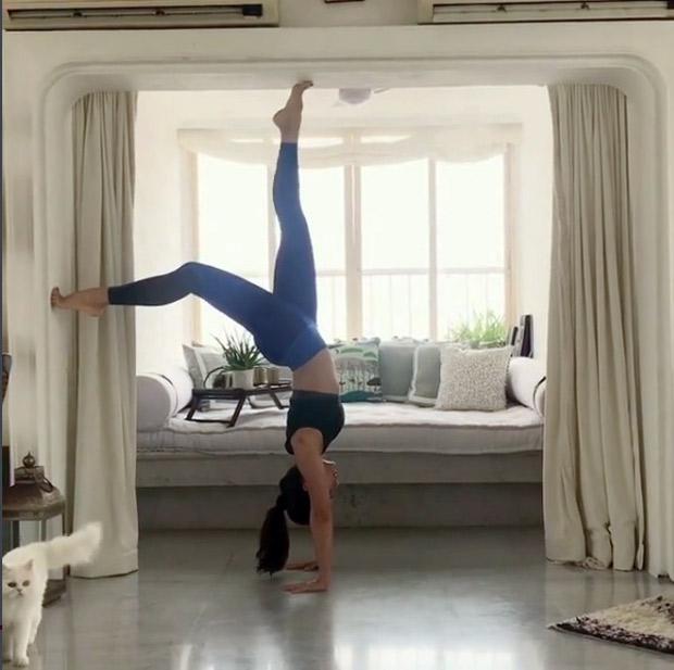 OMG! Flexible hottie Jacqueline Fernandez walks upside down in this cool video!