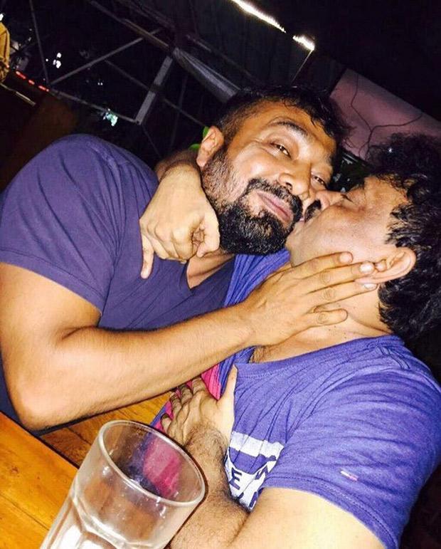 WTF! Ram Gopal Varma And Anurag Kashyap go a KISSING SPREE in a public place