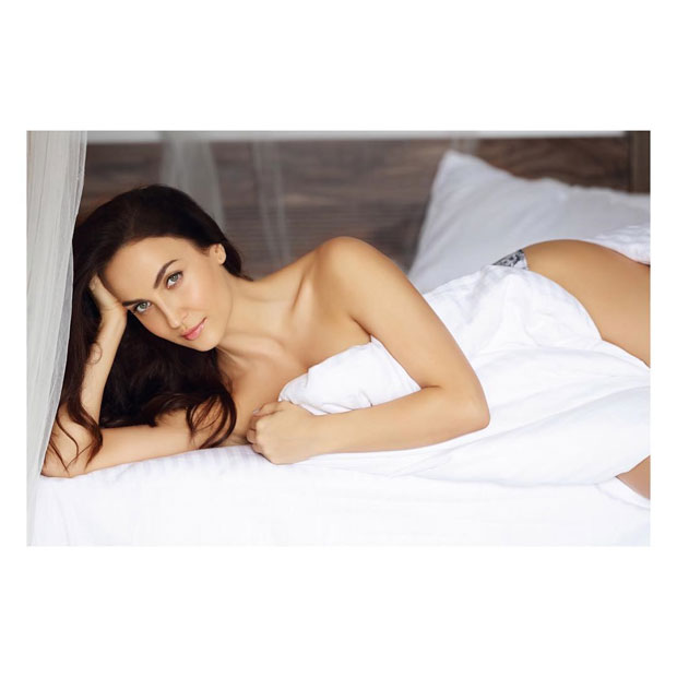 Check out Elli Avrram heats it up in her latest photoshoot posing with just a bedsheet