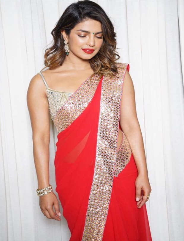 Priyanka Chopra flaunts bright red lips and textured hair