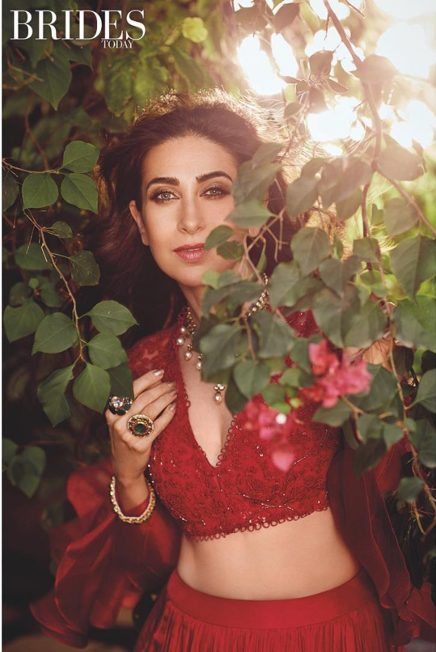 As one of the consistently impeccable sartorial stunners in tinsel town, Karisma Kapoor is always a hoot! While others attempt and falter, Karisma has clearly figured out styles that suit her petite frame with occasional experimentation. Daring silhouettes, unusual fabrics and flattering cuts mark her signature style which she pulls off with an understated aplomb. Describing her own style as classic chic, Karisma Kapoor's ladylike choices are always a delight. Karisma features as the cover star for this month's Brides Today edition. Giving us a glimpse of her ethereal charm, Karisma is dressed to nines in some of the stunning creations by designer Ridhi Mehra. Additionally, this edition allows us ample insight with a day in her life – Fitness, Beauty and Diet! The jewellery sported by Karisma is from Rare Heritage, Om Jewellers and TBZ. The photoshoot has been lensed by Prasad Naik at The Great Eastern Home, Byculla in Mumbai and styled by Shaurya Athley. The glam squad features makeup artist Subbu and hairstylist Yianni Tsapatori. Here is a closer look at the cover and the rest of the photoshoot. Cover Star – Karisma Kapoor Karisma flaunts a champagne gold anarkali with a draped dupatta and embellished belt. Statement earrings, a haathphool and ring are the accessories of choice. A subtle makeup of defined eyes, nude lips and wavy half-updo round out her look. Red Alert – Karisma Kapoor Karisma flaunts a bright red creation with black lacy heels, necklace and wavy hair. Karisma wears yet another stunning creation – a lehenga with a pearl necklace and rings. Dreams Galore – Karisma Kapoor Karisma flaunts her curves in this pale coloured creation with an opulent necklace, minimal makeup and wind kissed hair. Pretty Pastels – Karisma Kapoor Karisma wears a pretty pink creation with jewellery, subtle makeup and wavy hair. Print on Print – Karisma Kapoor Karisma wears a printed creation with statement-making earrings, subtle makeup and wavy hair. Well, if you are lookin
