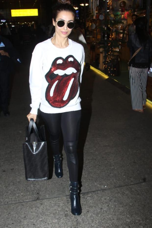 Malaika Arora in Madeworn Rolling Stones sweatshirt at the airport (3)