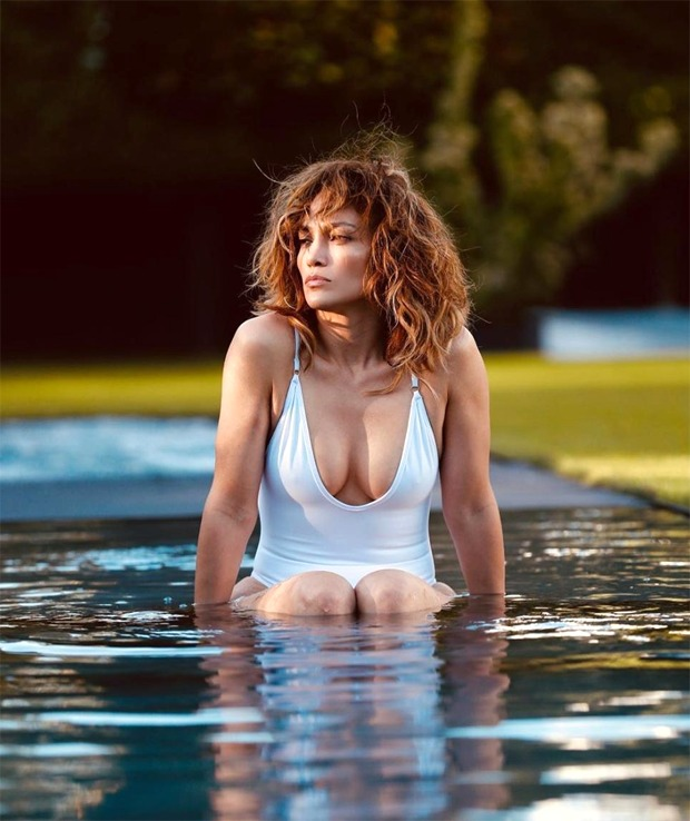 Jennifer Lopez dons white swimsuit in the swimming pool as she celebrates Earth Day