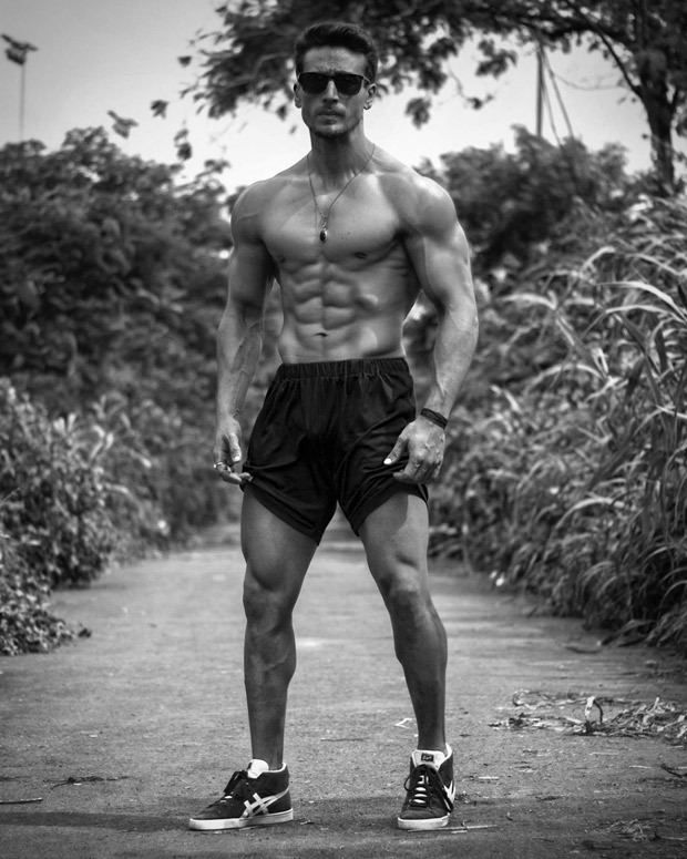 Tiger Shroff flaunts his killer washboard abs in this black and photo