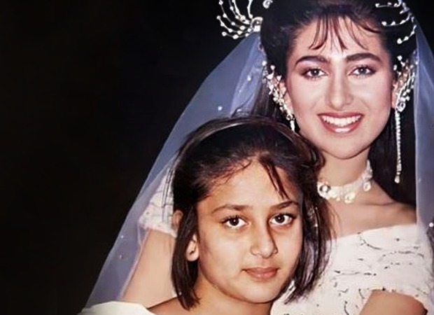 Karisma Kapoor dressed as a bride poses with Kareena Kapoor in this childhood picture