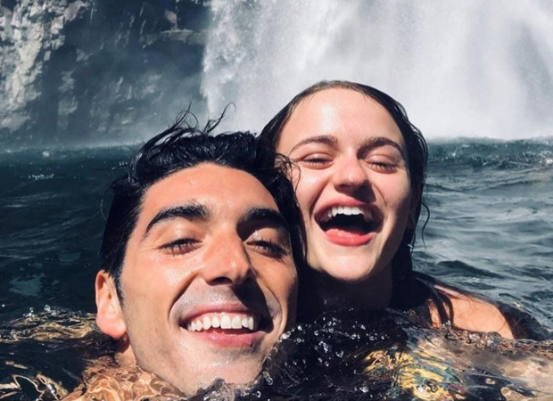 The Kissing Booth 2 stars Joey King and Taylor Zakhar Perez swim under a waterfall during their getaway with friends
