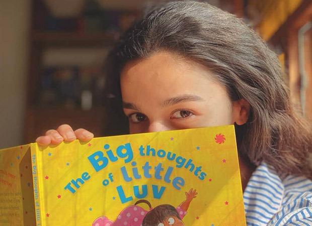 Alia Bhatt enjoys Karan Johar's book The Big Thoughts of Little Luv before heading for shoot