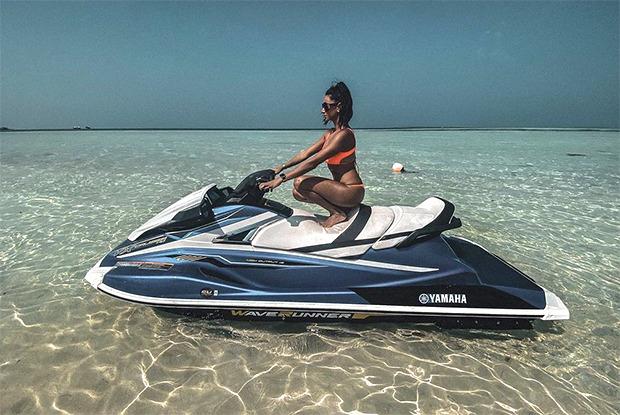 Shibani Dandekar soaks up in the sun in orange bikini while sittingon a jet-ski in Maldives