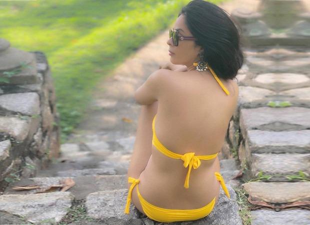 Mallika Sherawat poses in a yellow bikini as she gets ready to bid adieu to 2020