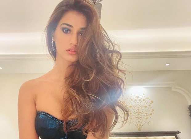Disha Patani looks like a sultry beauty dressed in a bodycon dress with a thigh-high slit