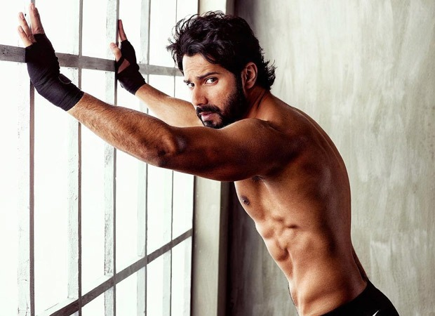 HAWT! Varun Dhawan flaunts his chiseled abs with an intense expression as he poses shirtless