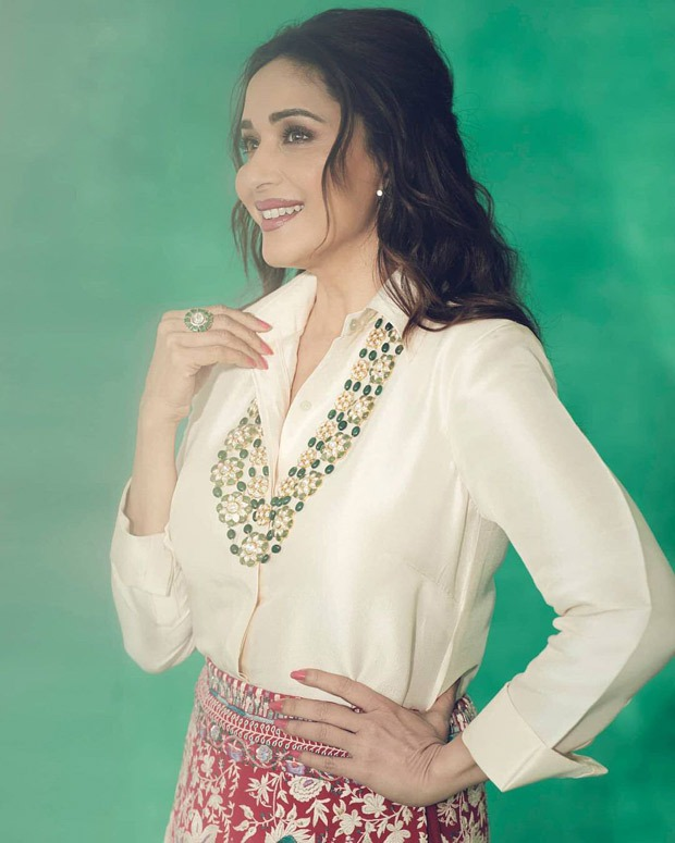 Madhuri Dixit gives modern contemporary feels by pairing a satin shirt with red lehenga skirt
