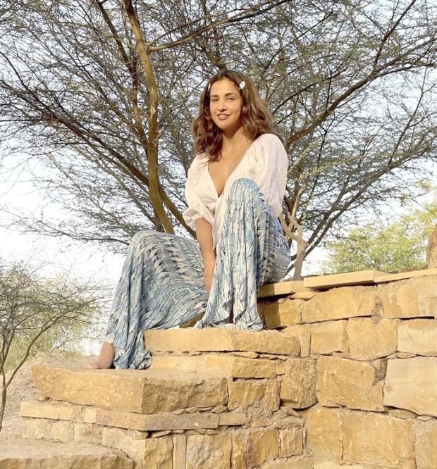 Aisha Sharma sets summer vibe in white crop top and flared pants
