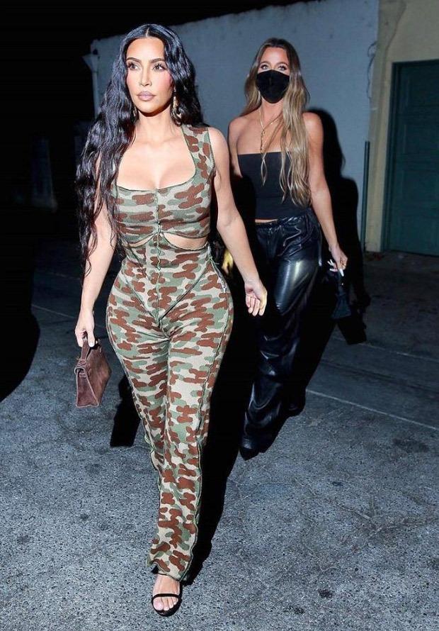 Kim Kardashian dons camouflage print jumpsuit with sister Khloé Kardashian for dinner