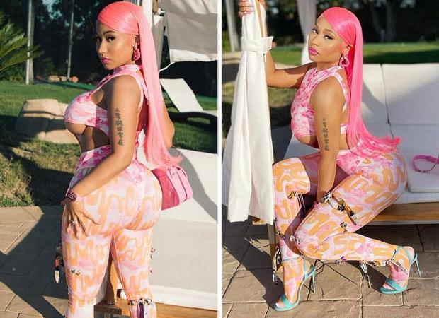 Nicki Minaj looks like an actual Bratz doll in risky pink and orange figure-hugging jumpsuit