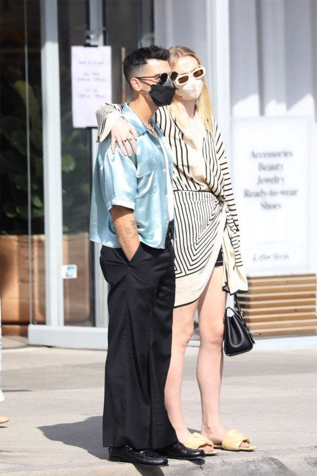 Sophie Turner dons striped wrap dress during Mother's Day outing with husband Joe Jonas
