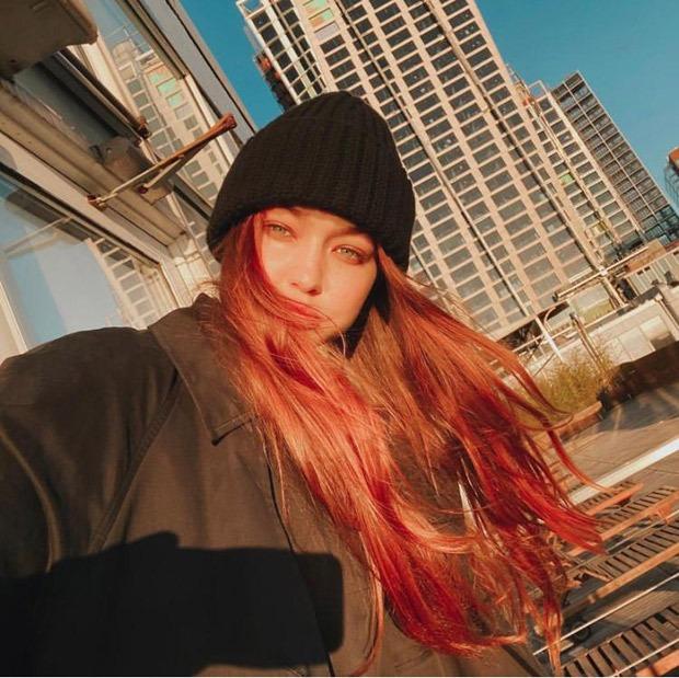 Gigi Hadid flaunts her red hair in a glowing selfie