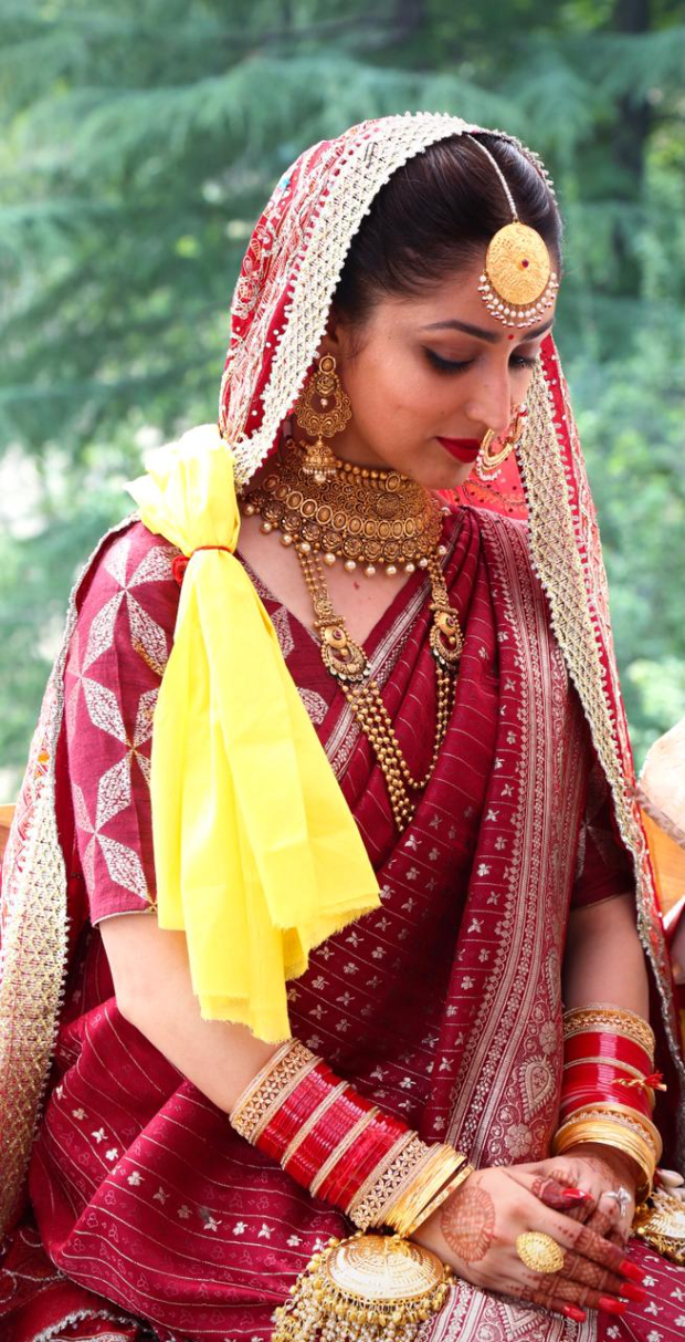 Yami Gautam wore her mother's 33-year-old traditional maroon silk saree for her wedding