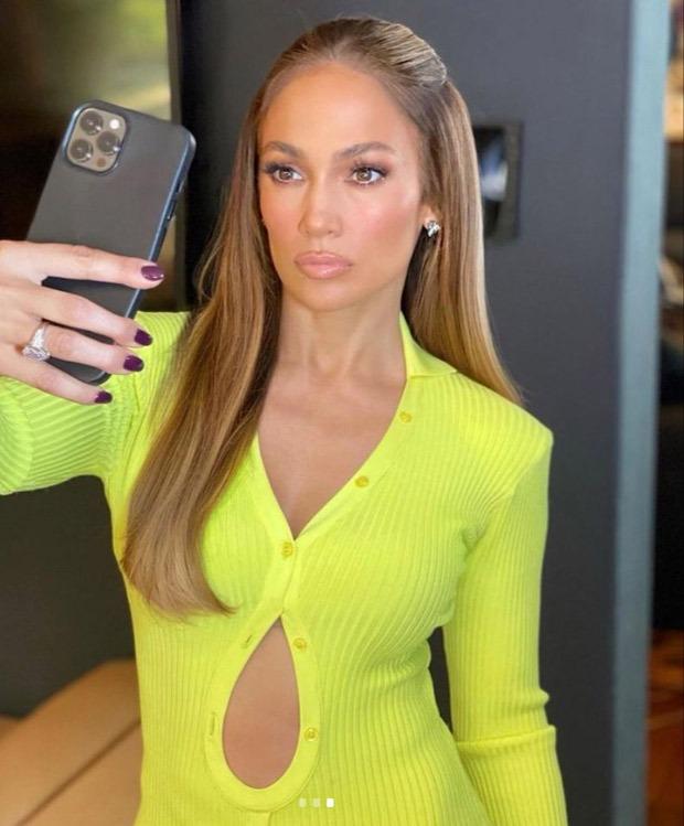 Jennifer Lopez looks ravishing in a neon dress