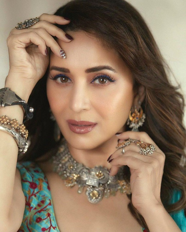 Madhuri Dixit looks gorgeous in a Turquoise pre-draped saree from Punit Balana worth Rs.35,500