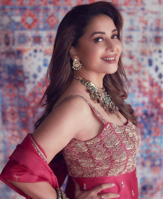 Madhuri Dixit looks gorgeous in a cherry red gharara from Punit Balana worth Rs. 75,000