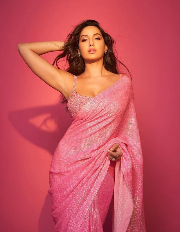 Nora Fatehi in a pink sequin saree paired with bright studded bralette is jaw-dropping