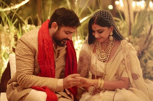 Rhea Kapoor shares her first wedding picture with her husband Karan Boolani donning ivory Anamika Khanna lehenga