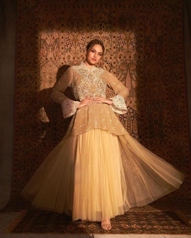 Sonakshi Sinha looks breathtaking in beige thread work ensemble cape and skirt by Ritu Kumar worth Rs.36,900