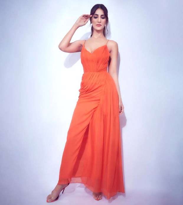 Vaani Kapoor looks gorgeous in a Tangerine dress for BellBottom promotions