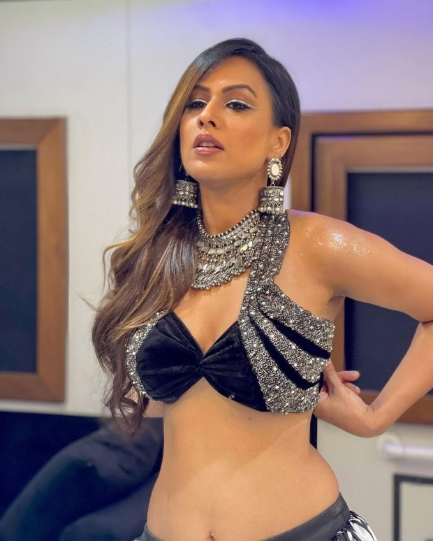 Nia Sharma turns up the heat in embellished halter-neck top with abstract print layered skirt for promotions of 'Garbe Ki Raat'